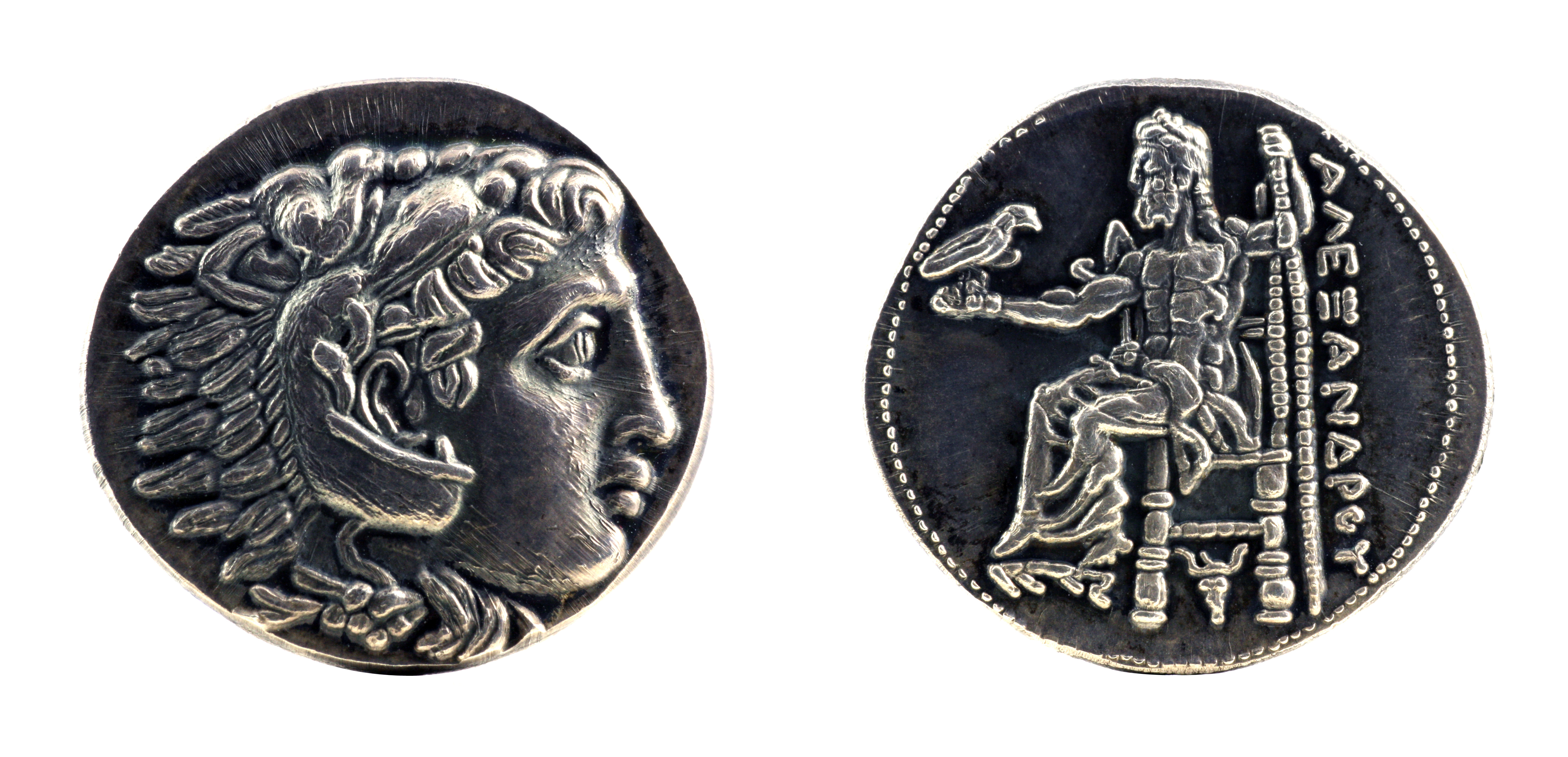 Greek silver tetradrachm from Alexander the Great showing Hercules wearing lion skin at obverse and Zeus at reverse, dated 323-315 BC. Image courtesy Adobe Stock.
