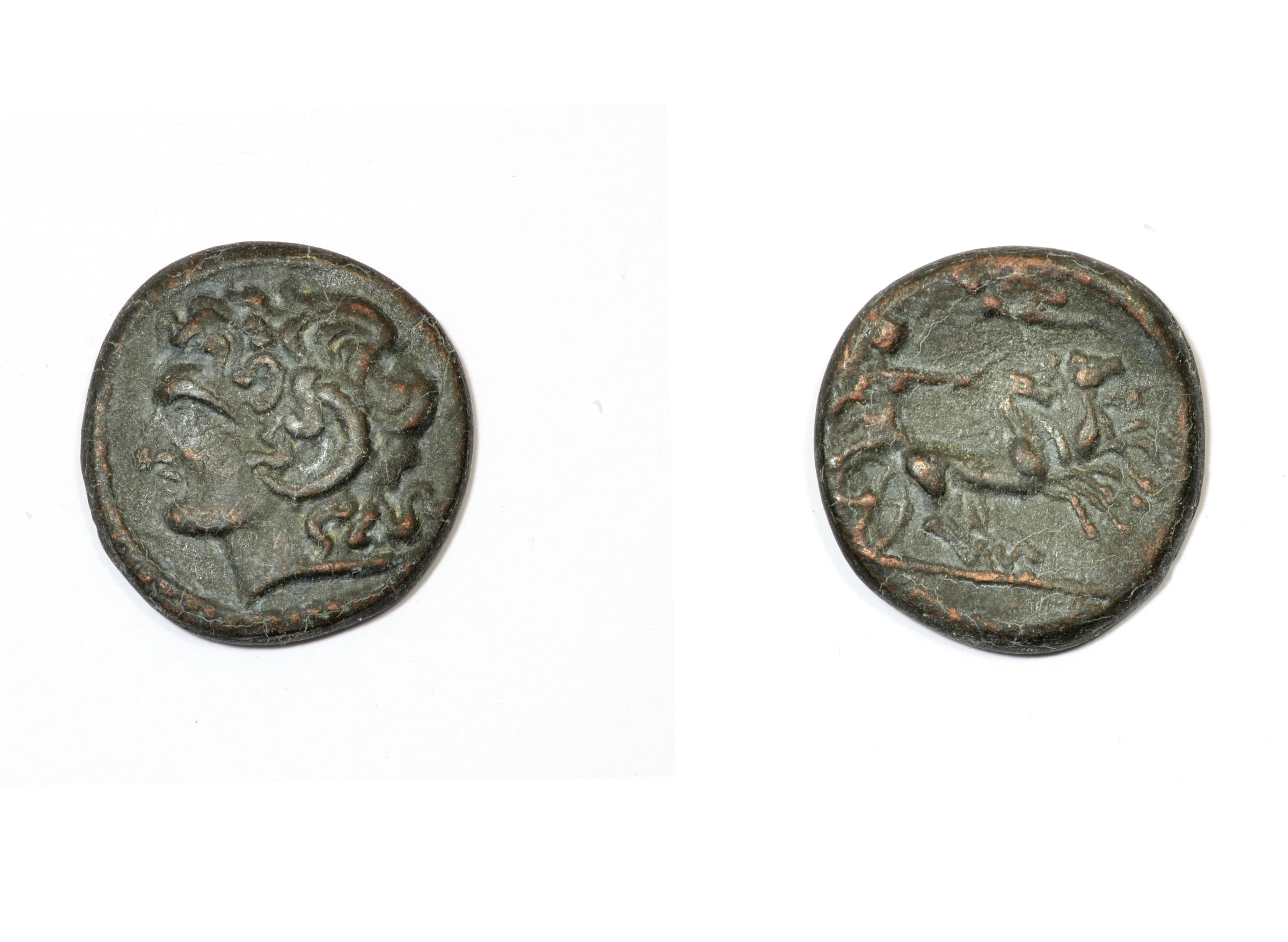 Ancient Greek coin. Alexander the Great and Apollo with the chariot of the sun. Image courtesy of Adobe Stock.