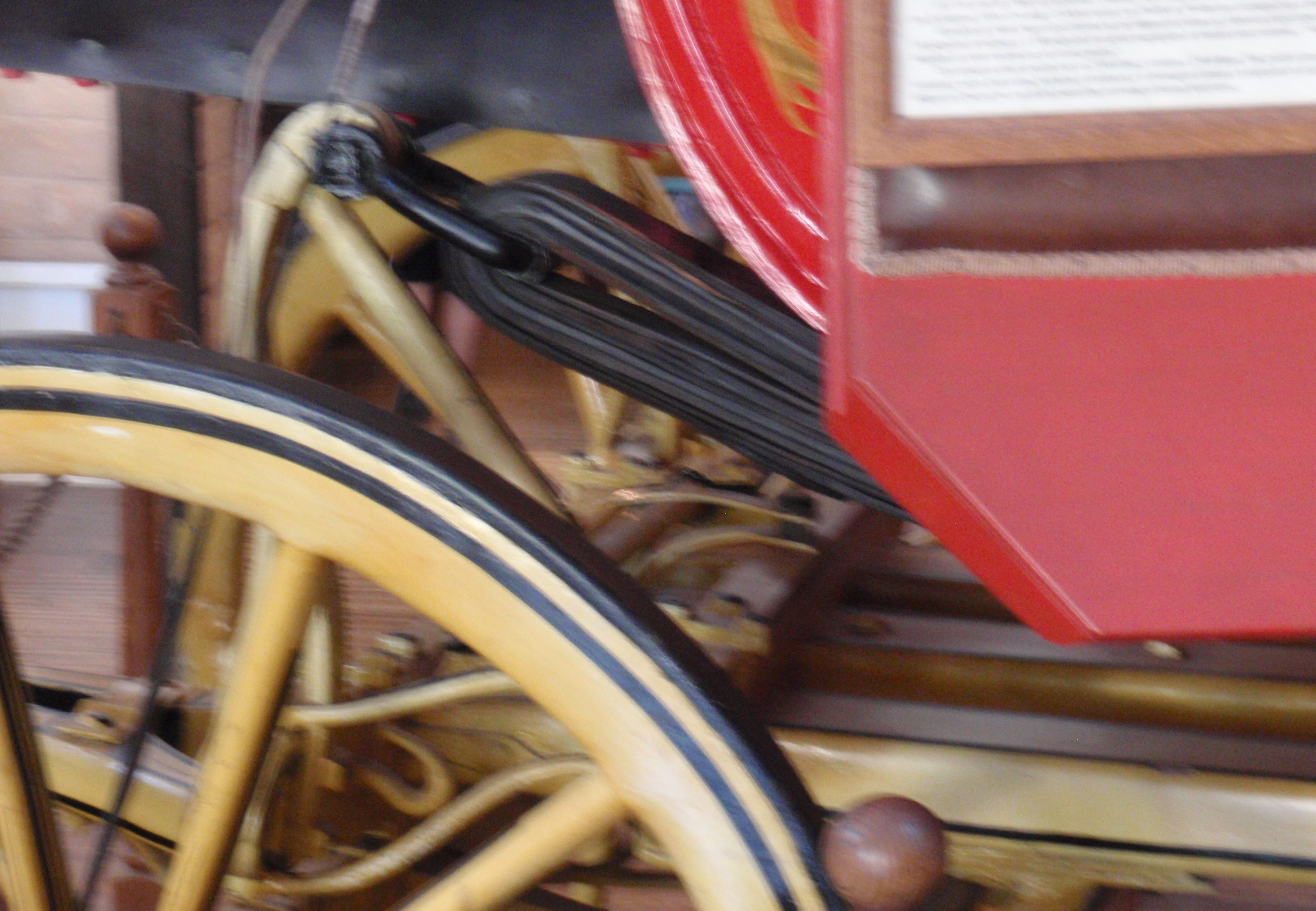 Out of focus view of suspension on a Concord coach. October 2016 photo at Wells Fargo's museum in San Diego by James Ulvog.