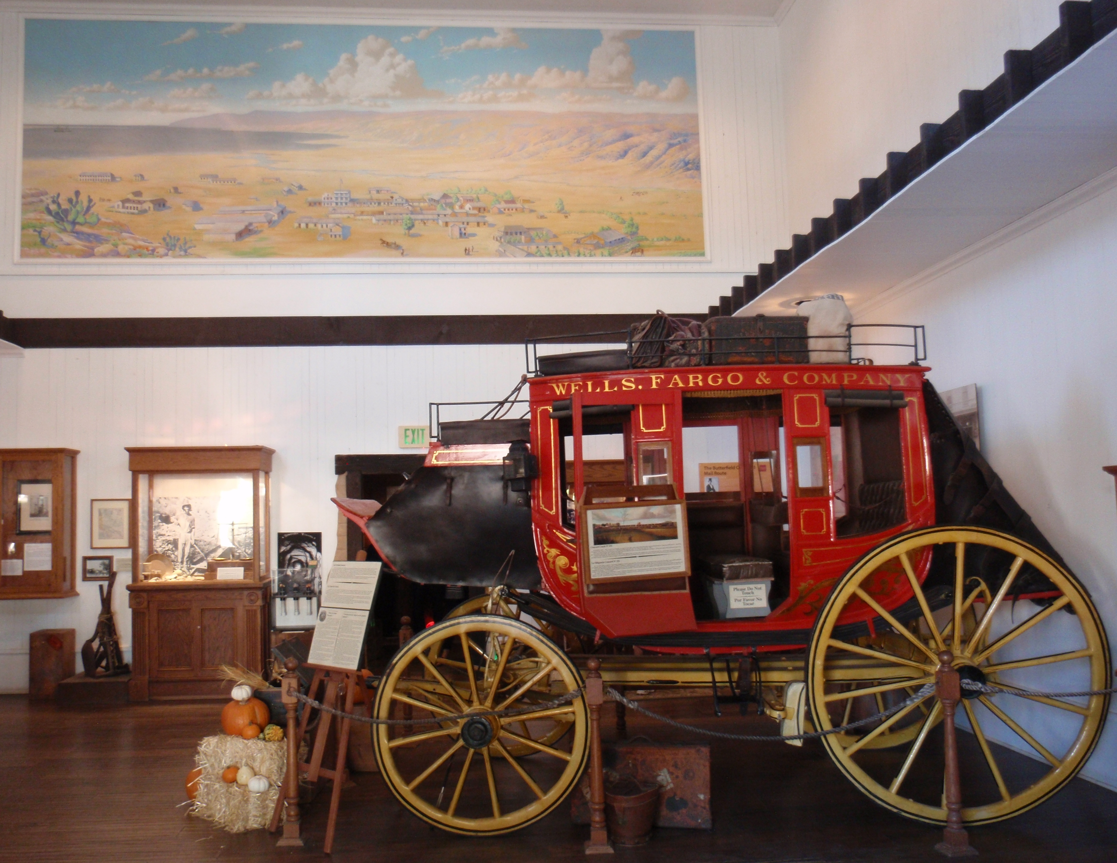 Concord stage coach at Wells Fargo museum in San Diego. Painting at top is of Old Town San Diego in its prime time. Photo by James Ulvog.