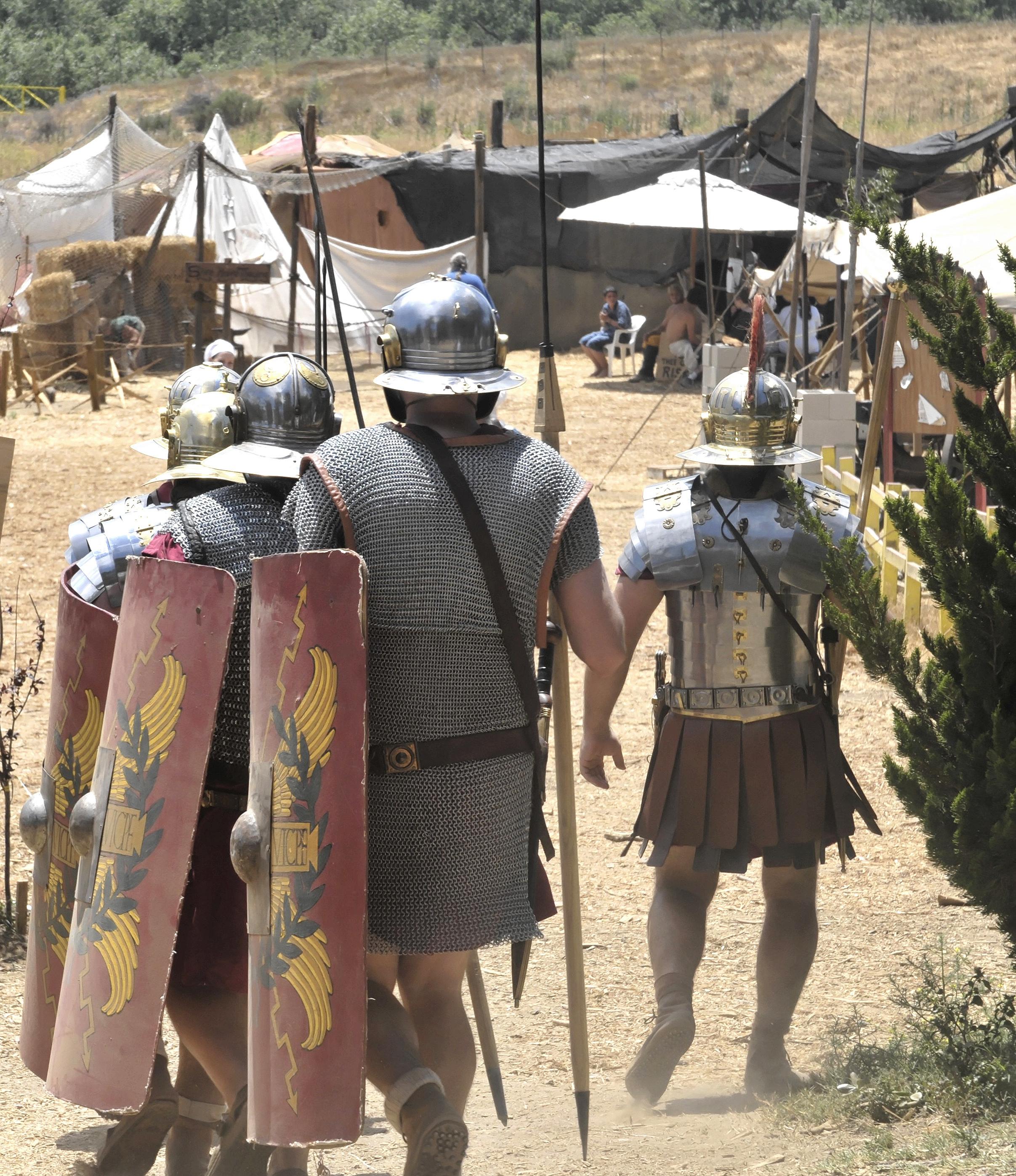 Roman soldier reenactors in camp. Photo courtesy of Adobe Stock.